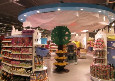 A playful cloud-like ceiling solution, suitable for a cheerful space such as this.