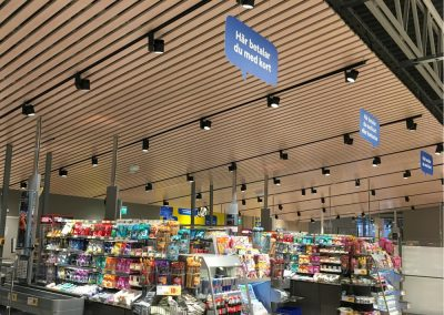 It sits above the checkout lanes, sloping gently towards the exit. A hopefully relaxing end to a visit to the store.